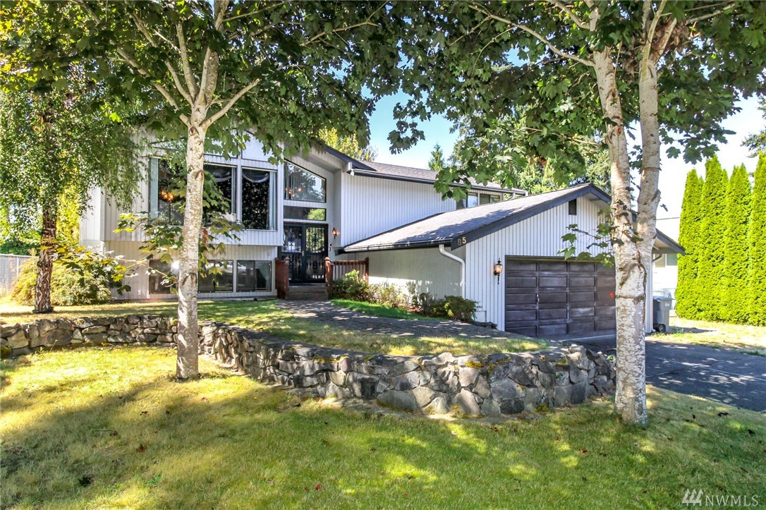 Lots of potential in this mid entry home, spacious living room w/fireplace & vaulted ceilings,Formal dining w/sliders to lg deck overlooking the  fenced bk yard.3 bedrooms the master has a private bath,the lower level has a 3/4 bath a huge rec room plus a separate family room  2 car garage & RV parking.  7 year old roof & leaf guard gutters. Located in a great Milton neighborhood