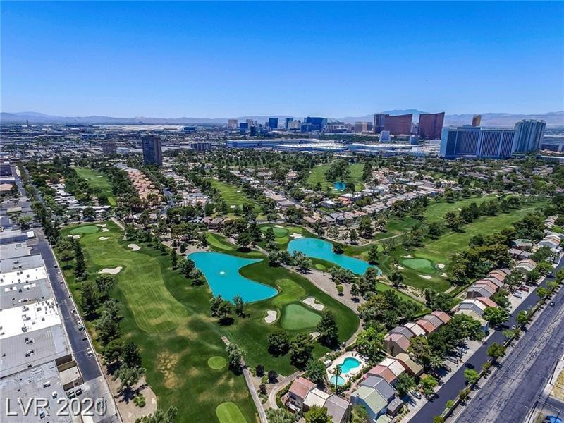 "PRICE REDUCED!!! BEAUTIFUL HOUSE ON THE GOLF COURSE! QUIET ENCLAVE . GUARD GATED. PRIVATE GATE ONTO THE GREEN. SPECTACULAR VIEW OVER FAIRWAYS & STRIP RESORTS. POOL, 3 BEDROOM , 3 BATH PLUS A DEN. INCLUDES THE FURNATURE.  TILE FLOORS THROUGTOUT. 2 AC UNITS TWO YEARS OLD. ENTERTAINER'S ROCK 30X20 LIVING ROOM OPENS TO HUGE ""PARTY PATIOS"" . SUPER LANDSCAPED YARD. GOURMET CHEF'S KITCHEN WITH GRANITE TOPS . FORMAL DINING ROOM. 28X18 MASSIVE MASTER BEDROOM WITH GIANT BATHROOM & KING-SIZE. WALK IN CLOSET . ELECTRIC SHADERS. 3 BALCONY. ALL FURNITURES STAY WON'T LAST....MUST SEE..."