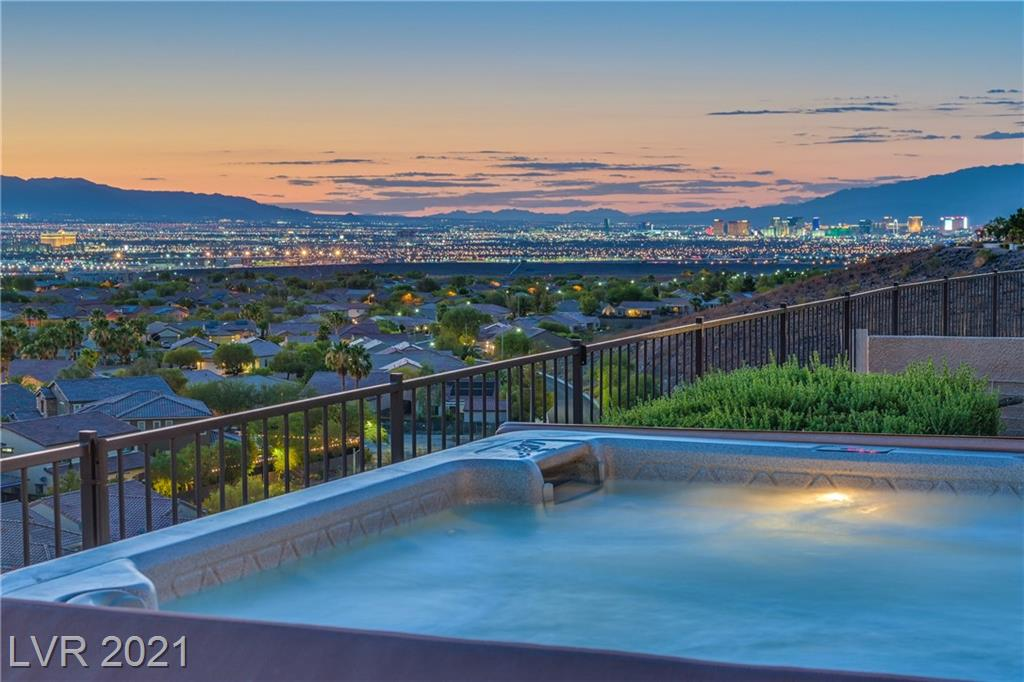 HANDS DOWN MOST SPECTACULAR VIEW IN ALL OF SUN CITY ANTHEM! SITUATED ON A QUIET CULDESAC ON A LARGE ELEVATED LOT IS THIS MAGNIFICENT 2592 SQFT 2 PRIMARY BED/2.5 BATH + DEN CONCORD MODEL. GATED COURTYARD ENTRY W/ FOUNTAIN AND DESIGNER SECURITY DOORS. FROM THE MOMENT YOU ENTER, THE VIEW TAKES YOUR BREATH AWAY! OPEN, SPACIOUS GREAT ROOM WITH WET BAR, WRAPS AROUND TO LIVING DINING AND KITCHEN ALL WITH SUBSTANTIAL VIEWS! SKYLIGHTS IN KITCHEN AND FOYER FILL THE HOME WITH NATURAL LIGHT. LARGE KITCHEN ISLAND WITH CABINETS AND LOADS OF COUNTERS AND STORAGE! 10 DESIGNER CEILING FANS INCLUDING THE PATIO AND COOLED OVERSIZED 3 CAR GARAGE! EXTRA LARGE 1,140 SQ FT COVERED PATIO WITH SOLAR DROP SHADES CREATES AN ADDITIONAL OUTDOOR LIVING AREA! FLAGSTONE ELEVATED VIEWING DECK, WATERFALL, POND AND X-LARGE SPA WITH SWEEPING VIEWS OF THE MOUNTAINS, CITY AND THE FAMOUS LAS VEGAS STRIP SKYLINE. INCREDIBLE SUNSETS! ALL THIS IN TOP RATED SUN CITY ANTHEM COMMUNITY.