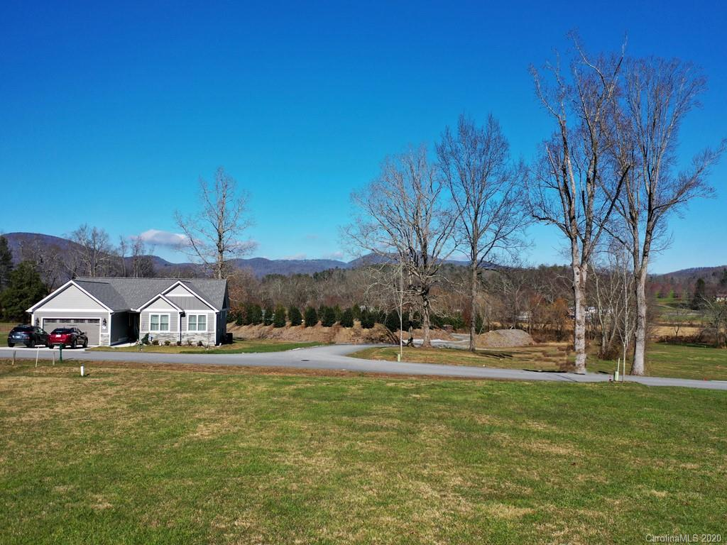 Looking for a beautiful space to make your own in the gorgeous mountains of NC? This homesite is ready and waiting for you at Vista at Blacksmith Run! Gated community living with the quite you desire and yet only 15 minutes from downtown Hendersonville or 20 minutes from Lake Lure.  This community boasts amenities such as a gated entrance, clubhouse, pool, fitness center, pond and walking trails. No need to find a gym with all this right at your fingertips!