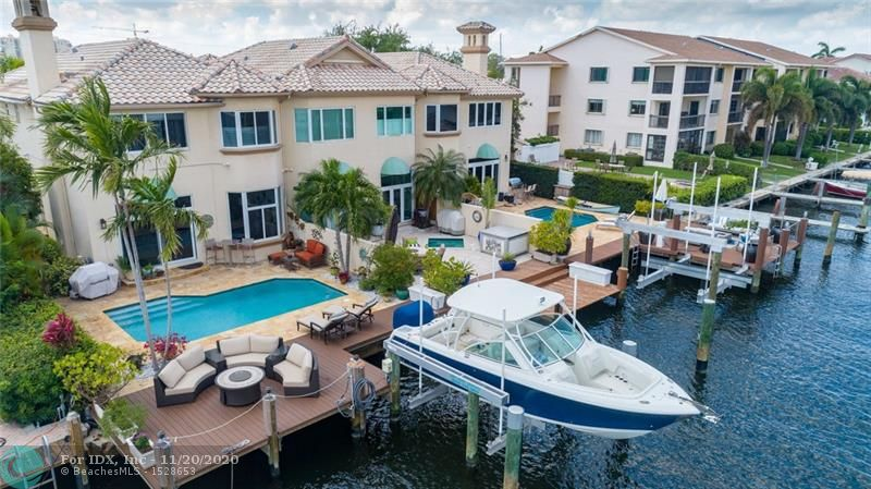 Unique 3/3.5 + private office, 2 car garage on deepwater only 2 homes off Intracoastal Waterway has the feel & privacy of a single family home. Watch the action on the Intracoastal Waterway from your extended deck with Birch State Park in the background. In the Coral Ridge Yachting Community, this unit is one of three in the complex & located on the East end corner. Features: Impact windows/door, all bedrooms have private on-suite baths, 10ft ceilings, personal full-size pool, boat lift, already raised seawall to the new code, fireplace, separate laundry room upstairs, private entry, extra-long & wide Chicago brick driveway that provides parking for 4 more cars, on a cul-de-sac street, coffered ceiling in dining area+. Bayview school district, minutes to the beach, park & Ft Laud Airport.