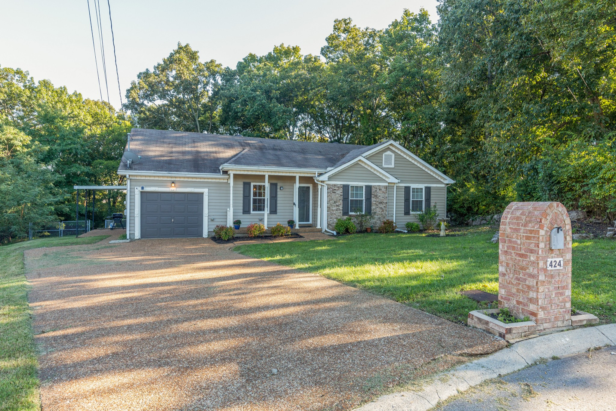 Updated 3 bedroom, 2 bath home. This home is move in ready and has new flooring and paint throughout! One level home on a large lot. Screened in patio, private back yard, and storage sheds stay! Water heater is 2 years old.