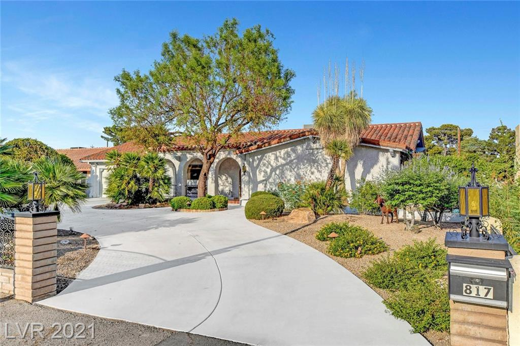 Gorgeous Spanish Style Oasis. This Custom Home features beautiful arches, tranquil courtyard, tons of space with endless potential. The home sits on a nearly half acre lot with large circular driveway, Alleyway entrance to backyard, Two Garages front and back, big enough for storage as well as work shop, and crawlspace under the entire property. The home also features a separate private North Entrance leading to the attached casita/office, Perfect for work or Mother in law suite.  Other upgrades include, NEW AC unit, updated plumbing, updated electrical, plus much more!