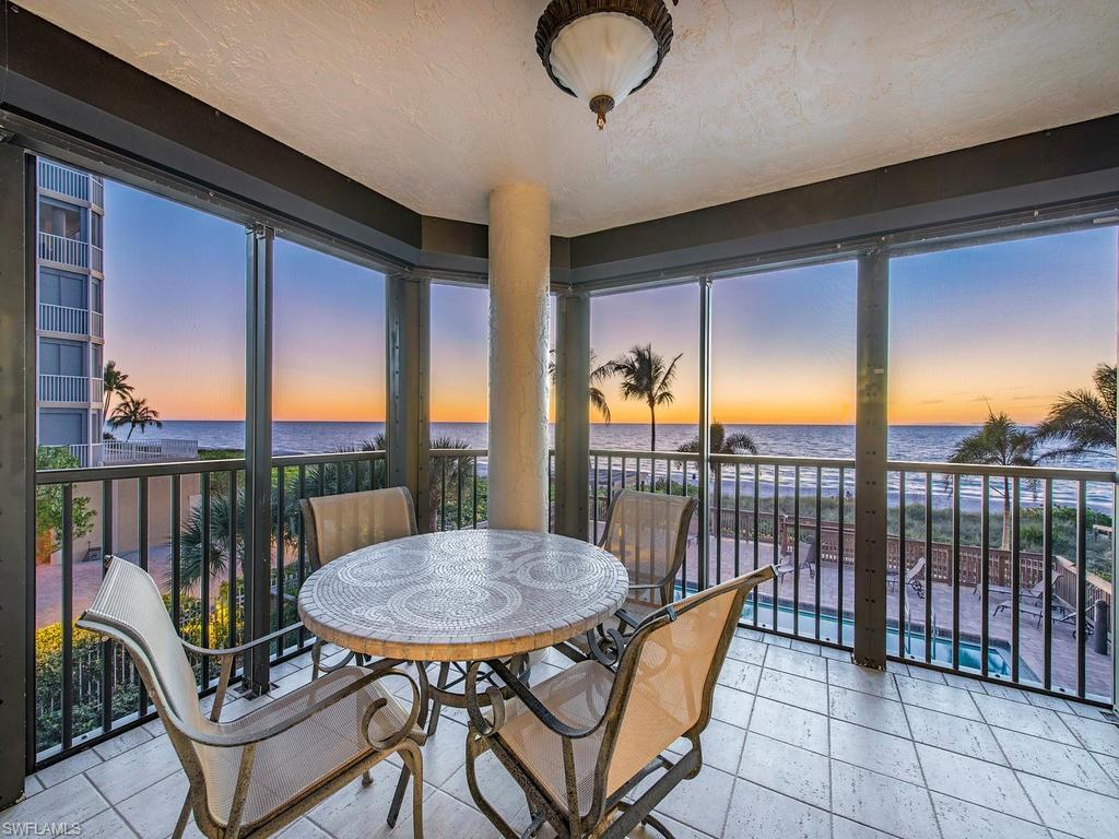C.17045 - Upscale 3/3 beachfront residence, only 3 per floor with over 2,000 sq ft of living area! Rarely offered end unit with magnificent wrap around lanai delivers glistening views of the Gulf of Mexico. End the day with mesmerizing sunsets! Floor to ceiling bank of sliders allows for a bright and sunny living room. Updated kitchen cabinetry with granite countertops and stainless-steel appliances. Spacious master bedroom on the Gulf plus two generously-sized bedrooms. Master bath equipped with 2 walk-in showers. See yourself relaxing by the beach pool, lulled by the waves, and taking in the sights and sounds of living on the beach!  Only 26 residences to enjoy the beautifully renovated pool area and social room! Gated entry, secured lobby, on-site manager, brick pavers, BBQ station, additional gated parking on bay side, and extra A/C storage. The casual ambiance of Casa Grande is perfectly nestled between the Ritz and the LaPlaya which offers private beach and golf memberships.