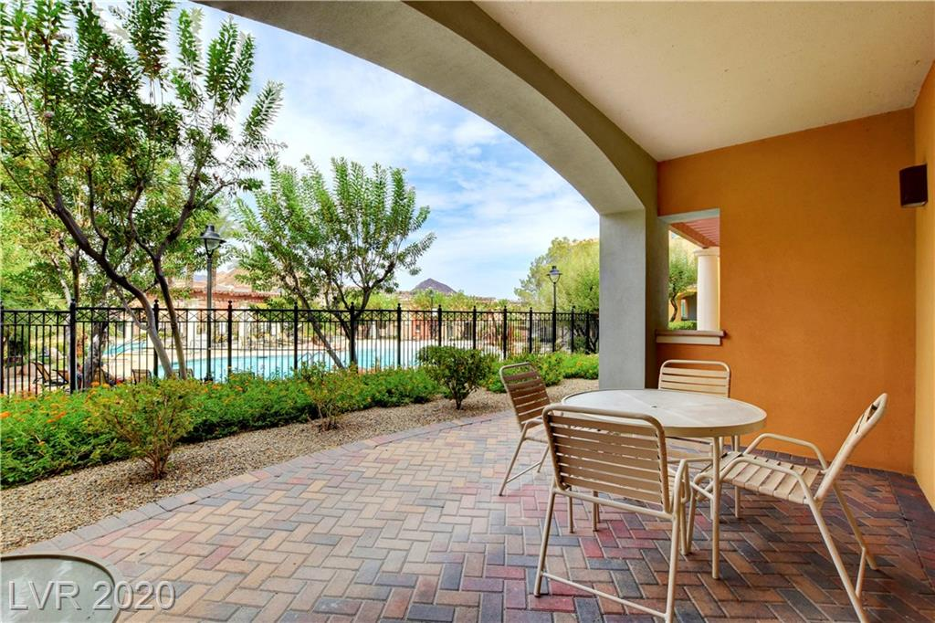 Located in the heart of Lake Las Vegas with easy access to restaurants, a grocery store, & outdoor activities, this well appointed, fully furnished, 2 bedroom walkout has a covered patio and poolside view. It boasts a full kitchen plus a washer/dryer hookup in the unit. The monthly fee includes utilities, amenities & parking. Great for both full time residents or investors looking to rent short or long term. 30mins to the strip.