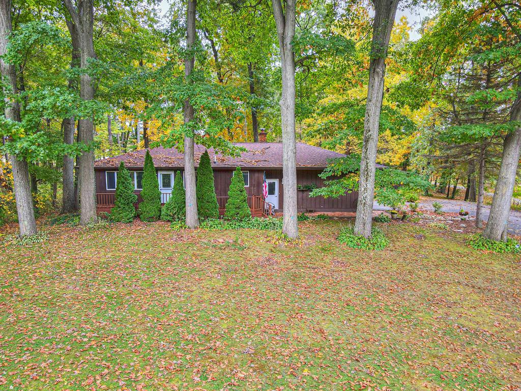 Located in Northwest Schools close to Pleasant Lake on 2.12 acres you'll find this fantastic ranch home offering 3BR/2BA, attached 2.5 Car Garage, beautiful lot w/ 2 Pole Barns-one that's 1440 sq.ft. & offers concrete floor, electricity & water, part of barn is also heated w/ hydraulic car lift as well as a 768 sq. ft. barn w/ 1 large stall with dirt floor for horses, goats, etc. & concrete floor. Beautiful Hickory & Oak Trees & perennials pepper the backyard as does a small decorative fish pond. Enter into kitchen w/ pantry, breakfast bar, open to living/dining room, 2BR/1BA on main level. Lower level offers 3rd BR, 2nd full bath, home office, wet bar/kitchenette, wood stove that can heat the whole home, utility room & laundry w/ walkout to patio! You will just love this country setting!Updates in the last 5 years include: water heater, water softener, RO System, back deck, kitchen appliances, sump pump and 2 wall units that offer dehumidifier, heat, fan and central air with remotes.