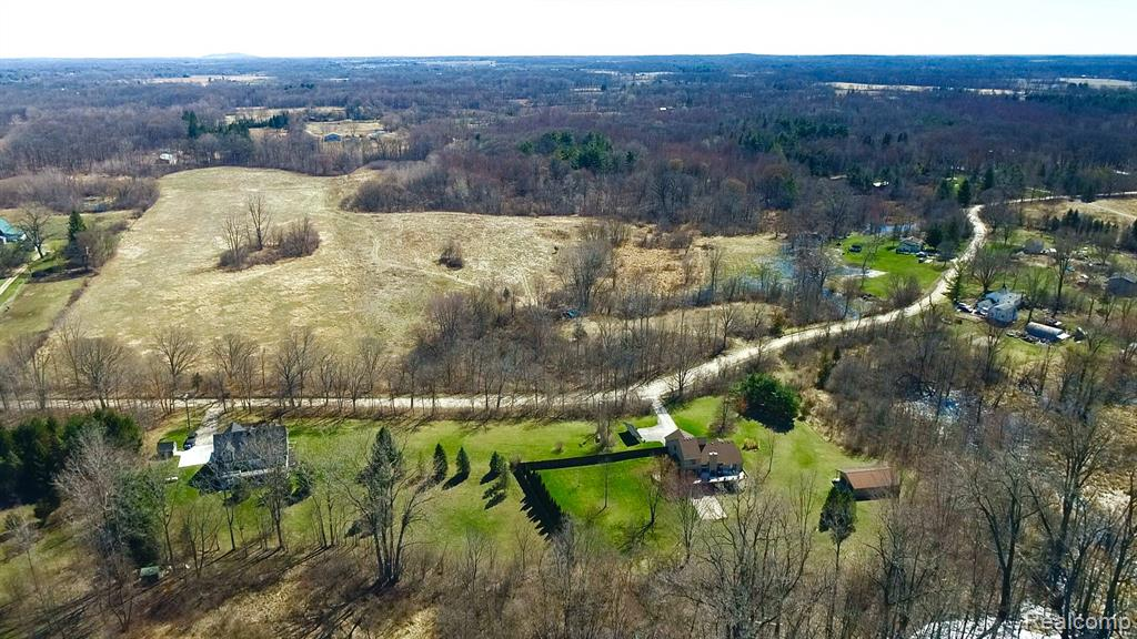 The BENEFIT of this 37.75 Acre LAND... MULTIPLE SFH lots (Build a house on front acreage & another house on the back acres). TWO PREMIUM HOMESITES for one price w/ time to adjust the split the way you want it. Located in Northfield Twp w/ Whitmore Lake Schools & Mailing. THIS LAND is a MUST SEE IN PERSON to appreciate the ROLLING partially wooded acreage. Some wetlands promote the ultimate wildlife habitat. Zoning allows for Single-Family Home w/ additional structures (barn, horse arena, pole barn, detached garage, workshop, guest house, etc), recreation activity, organic farming, hunting & more. Possible walkout/daylight basement. Located south of 7 Mile Road & very near Whitmore Lake. Access US-23 in less than 8 minutes. THE DRIVE TO THE PROPERTY IS PICTURESQUE – COME SEE FOR YOURSELF. Convenient to Brighton, Whitmore Lake, Ann Arbor & other nearby areas such as South Lyon, Plymouth, & Northville. View Today! SEE AGENT REMARKS FOR ADDRESS DISCLAIMER