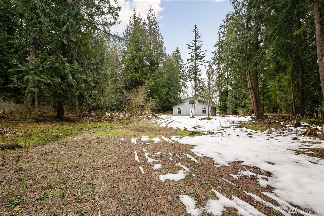 Don't miss your opportunity to build your dream home on this rare, private & level 4.5 acre parcel just minutes from downtown Redmond & Bellevue. Take advantage of the 2,496 sq. ft. barn/shop (finished in 2013) with durable metal roof, water & electricity. Or redesign, finish and make it your dream home. Property is fully-fenced with private well & electricity and is in the highly desired Lake Washington School District. Endless possibilities with this quiet, peaceful oasis.... don't wait!