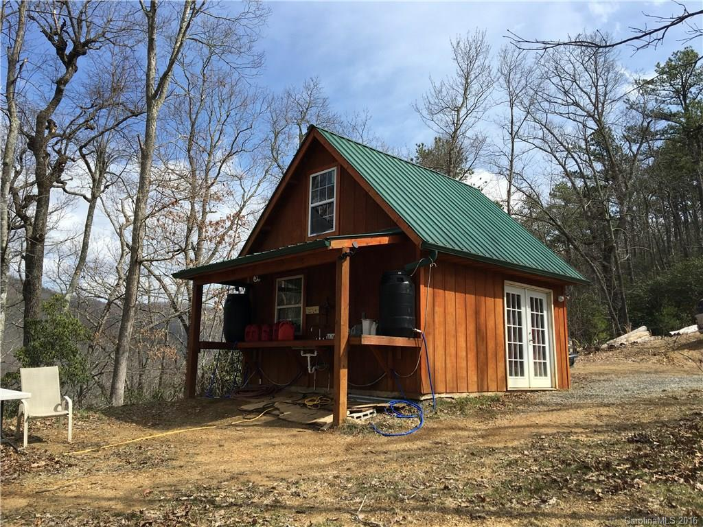 OWNER FINANCING AVAILABLE ! Rare, wilderness paradise!!  Spectacular 360 degree views on long level ridge-top, hiking and four-wheeler trails throughout property, good gravel road from valley, with year-round creek, to and along ridge-top to the end.  Heavily wooded with old growth trees, underground phone line, well and pump with generator, adorable small cabin with modern out-house, no overhead powerlines, no HOA, no annual fees, no close neighbors, no restrictions.  Will divide into 10+ acre tracts. Price lowered $100,000! PRICE FIRM!
