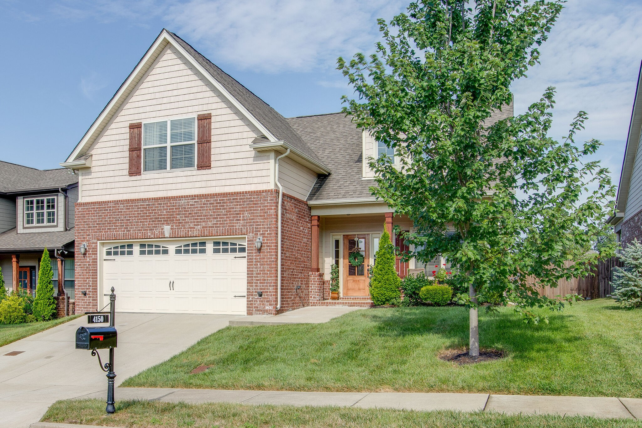 This beauty has it all, covered front porch, open floor plan, spacious master bedroom on the main level with two walk-in closets, second floor bonus room and secondary bedrooms, fireplace, covered back patio, lush backyard with a privacy fence, stainless steel appliances, hardwood floors and so much more.