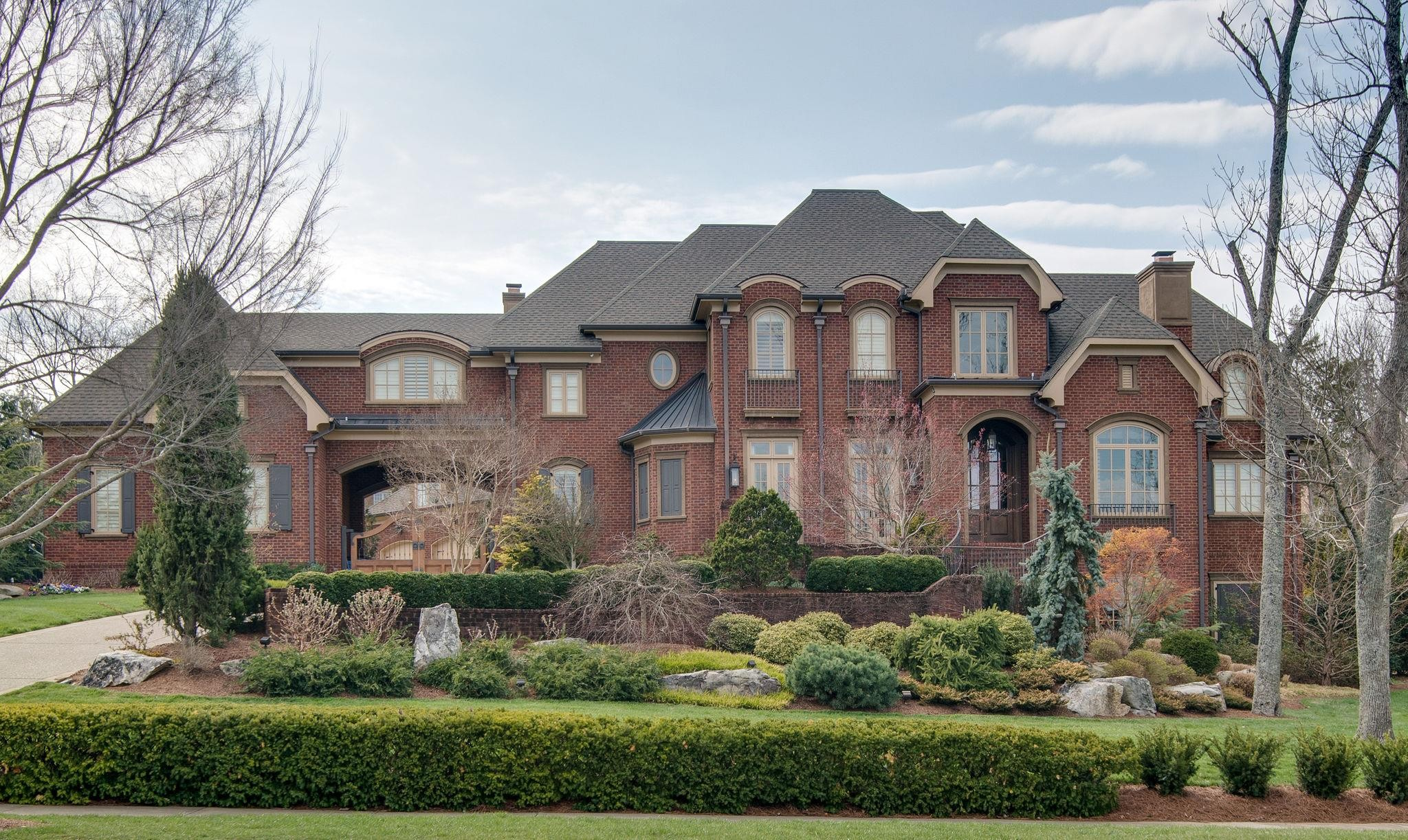 Fabulous European style home on private 1+acre lot. Cooks kitchen w/Calcutta Gold marble open to breakfast & family room. Walnut hardwoods, theater, resort pool w/slide, cabana w/outdoor kitchen, f/p & bath. Irish pub, wine cellar, safe room and in-law suite. Updated master bath, picture coming soon.