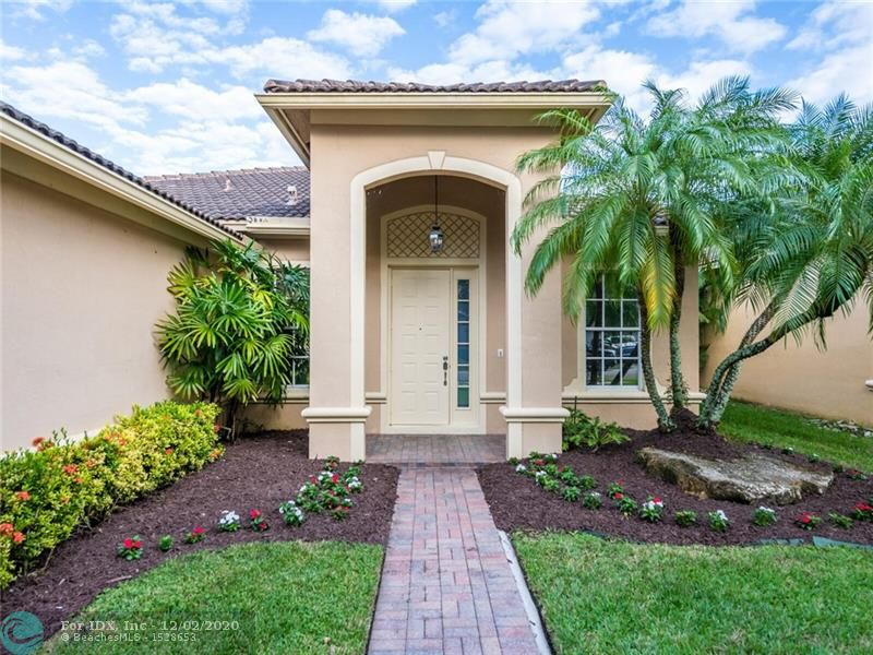 Incredibly maintained family home in gated community of Isles of Weston. Tile flooring throughout living areas, comfortable and ample kitchen with granite counter tops, full size washer/dryer, nice size backyard and more.  Home was recently painted and partially updated. Great time to buy and make it yours! Community offers amazing amenities such as: 24/7 security, clubhouse with pool, gym and more. HOA Approval- all info listed in disclosure docs. Taxes do not reflect Homestead. Priced to sell! Easy to show!