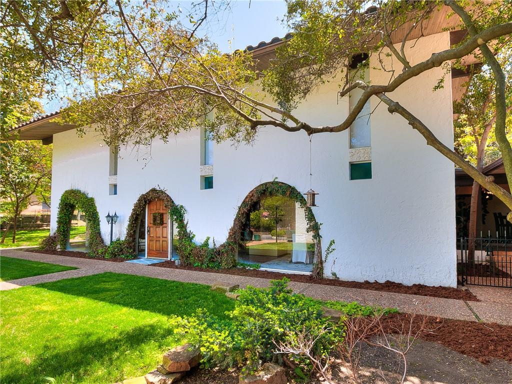 Listed for the first time in 45 years, this architectural and historical jewel is located on a private drive, just minutes from the University of Oklahoma. Truly a one-of-a-kind property, the home was built in 1964 by renowned modernist architect John G. York. This stunning Spanish Revival sits on ¾ acres (mol) and is wrapped in privacy by mature trees, an 8-foot courtyard wall and landscaped grounds. Unique design and unparalleled build quality set this home apart! The great room features soaring 24-foot ceilings, 1 of the home's 3 indoor fireplaces and floor-to-ceiling windows. Custom solid brass hardware and arched windows make it like no other! The resort style backyard features a pool and a large, covered terrace with built-in fireplace and grill.  Backyard cabana has kitchen, sauna, spa and shower. Wet bar, basement, water well, large garage, private neighborhood with green space and more!   Note: An additional bonus 800 sqft m/l between the cabana and the basement.