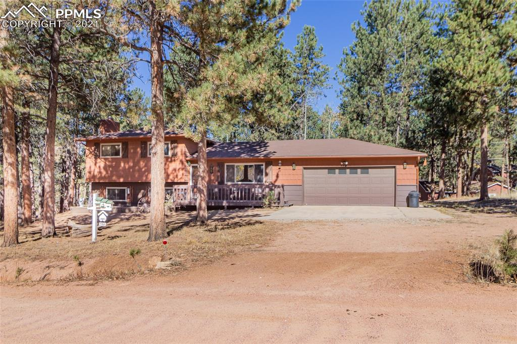 Here's your chance to own a wonderful split-level home on 1/2-acre lot in scenic Woodland Park! There is room for the whole family in this convenient 4-bedroom floorplan with main-level Living Room and lower-level Family Room. Spacious Master Suite with adjoining ¾ Bathroom, 2 Bedrooms and full, shared Bath on upper level. Family room, 4th Bedroom, and Laundry room in lower-level.  Gas log fireplace and classic rock surround & hearth ensure cozy, warm winters. Upper level vaulted ceilings with open beams.  Dining Room walks out to private wood deck that is perfect for barbecues and family get-togethers. Large back yard with mature trees and garden shed for extra storage. Located in charming Sunnywood Manor neighborhood within city limits. Enjoy starry nights and visiting wildlife in a quiet setting near hiking, biking, and OHV trails. This home is perfect for families and investors alike.  Don't wait to schedule your showing because this desirable home won't be around for long!