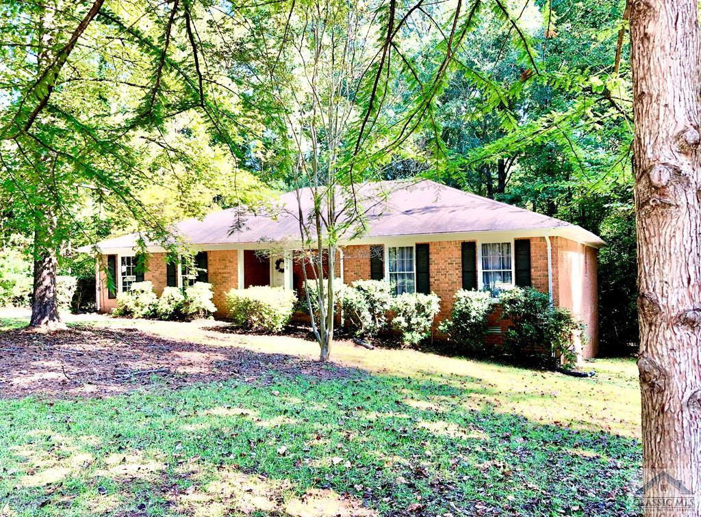 Get ready to fill out your CHANGE OF ADDRESS FORM! You will enjoy SINGLE LEVEL LIVING in this completely updated (in 2018), 4 Sided Brick Home located about five minutes from the UGA Vet School on Athens's East Side! Step inside your bright and spacious living area featuring a cozy fireplace, recessed lighting and your very own wet bar with lovely granite counter tops and glistening glass shelving. Stainless steel appliances, granite counter tops, pantry, and shiplap backsplash make for a bright and airy kitchen completely open to your dining and living room. Serve up a feast in your delicious dining room overlooking your private, wooded backyard. The palatial owner's suite features a gorgeous attached bath and spacious walk-in closet. Two additional oversized bedrooms share a sparkling and fresh hall bath with a brightly tiled shower. Glowing REAL hardwood floors run throughout the home and were completely refinished in 2018. Established landscaping and gorgeous trees surround your lovely home. Don't let this one slip by! Call today!
