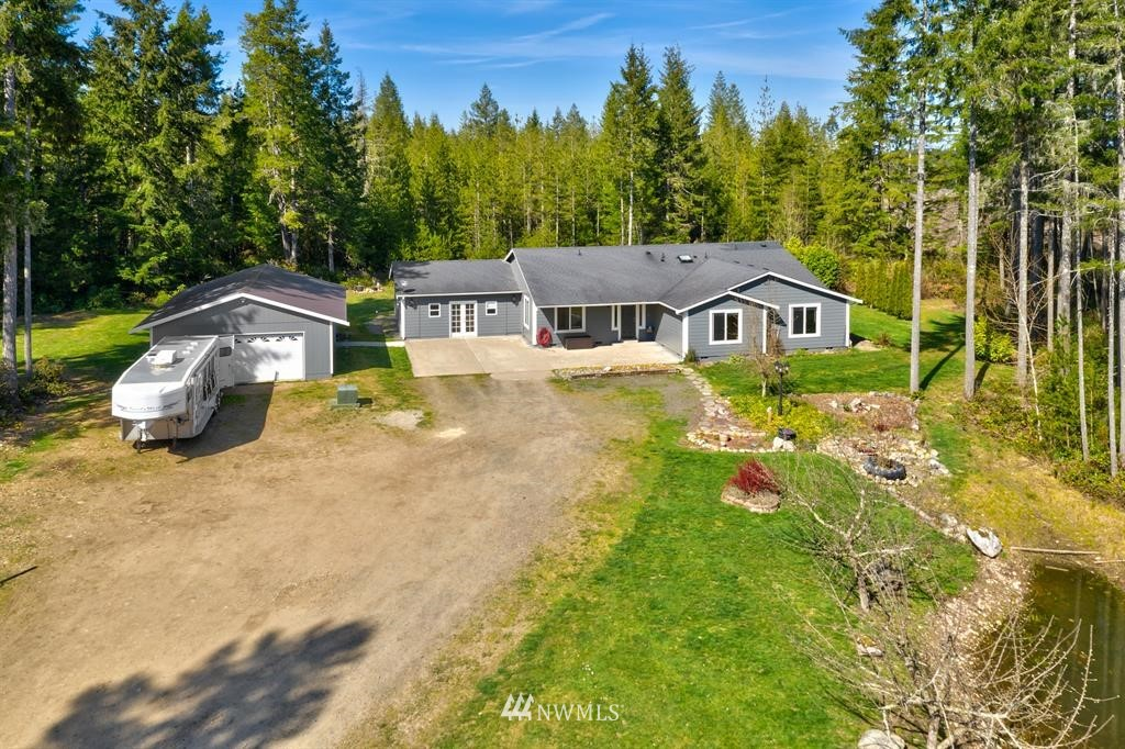 Equestrians, hold your horses! This is the one! Finally, a usable 5+ acres perfect for your farm or so much more! This single story is filled w/natural light, open kitchen, living rm & dining rm. Large master w/private bth and walk-in closet, 2 additional bdrms +bonus rm, and huge family rm. Outback you'll find a deck to entertain or take a soak in the pool! 100x150 site cleared for potential riding arena, 4 stalls w/2 fenced turn-outs, dog run, 24x36 shop/garage. NEW CARPET/PAD TO BE INSTALLED!