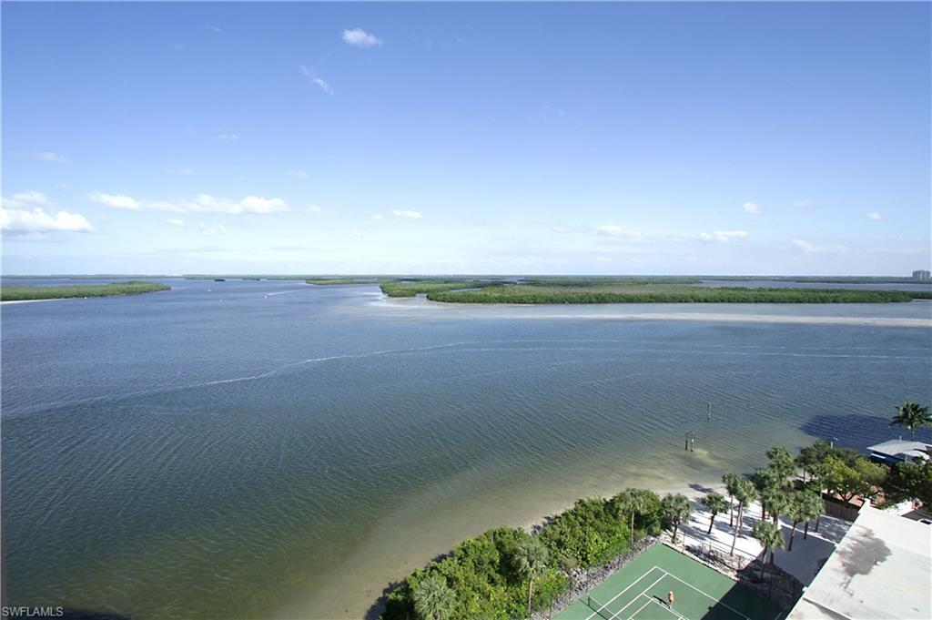 IT'S ALL ABOUT THE VIEW!  This rarely available, 11th floor unit has PANORAMIC water views.  The moment you step into the unit you're surrounded by breathtaking views of the Gulf and Bay. This spacious condo offers TWO separate lanais, one off of the master bedroom and another in the living/dining room.  Granite counter tops, first floor secured garage parking space, extra storage, electric hurricane shutters,  are just some of the fine features this beauty has to offer.  The prestigious GATED Island Beach Club has some of the finest amenities in the area including a large pool and spa, BBQ area, Fitness Room, private beaches, tennis, pickleball, and boat docks subject to availability.  Located next door to Flippers, conveniently located close to the airport, Fort Myers Beach, Coconut Point Mall or a short drive south to The Mercato.  Come own your piece of paradise today!