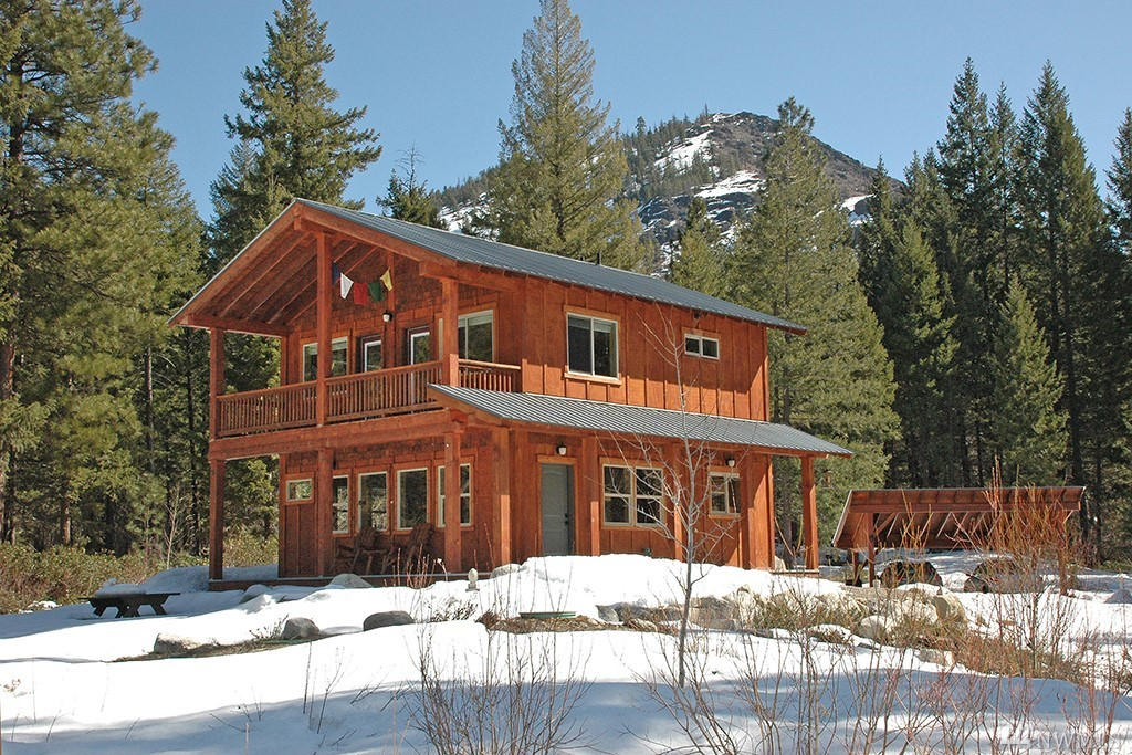 Spectacular sunny setting in the rugged upper reaches of Twisp River. Located in the 'Buttermilk Gap' between Newby Ridge & Scaffold Peak, natural light bathes this sparkling 2007 home year-round. Majestic Fir, Pine, meadows, 2 irrigation creeks offer great beauty & privacy, adjoining Nat'l Forest. Highly-efficient floor plan lives large! Lovely concrete floors, radiant heat, ceiling beams, well-placed windows. Quality thruout. Lg master & 2nd BR, office, sunroom. Special property off paved road