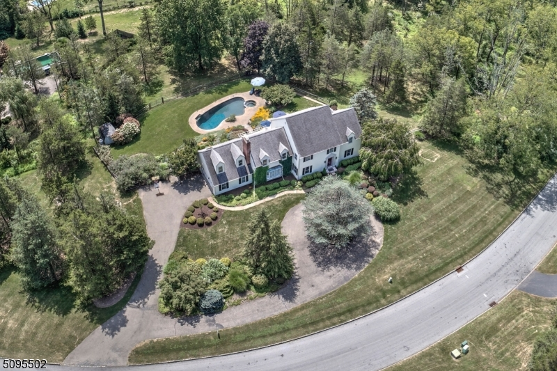 This Stately Colonial Residence invites an aura of excitement!  Its regal setting on two acs, embraced by an alluring landscape and circular drive, welcomes you to this exceptional 1985 young home with tasteful, quality remodels and updates to 2021, presenting (3800 sq ft) of lux country living, 4 bedrooms, 3.5 baths, remodeled gourmet kitchen w/top of the line appliances, spacious firesideprimary suite and spa bath, family room w/fireplace, elegant living and dining rooms, (900+ sf ft) partially finished lower level, a resort pool for lazy summer days and (1200 sq ft ) entertainment deck for al' fresco dining overlooking private grounds. Two car garage.  All this and more. OH!  By the way... minutes to Oldwick town and I-78 for commuting.  Under Ground Oil Tank will be removed prior to closing