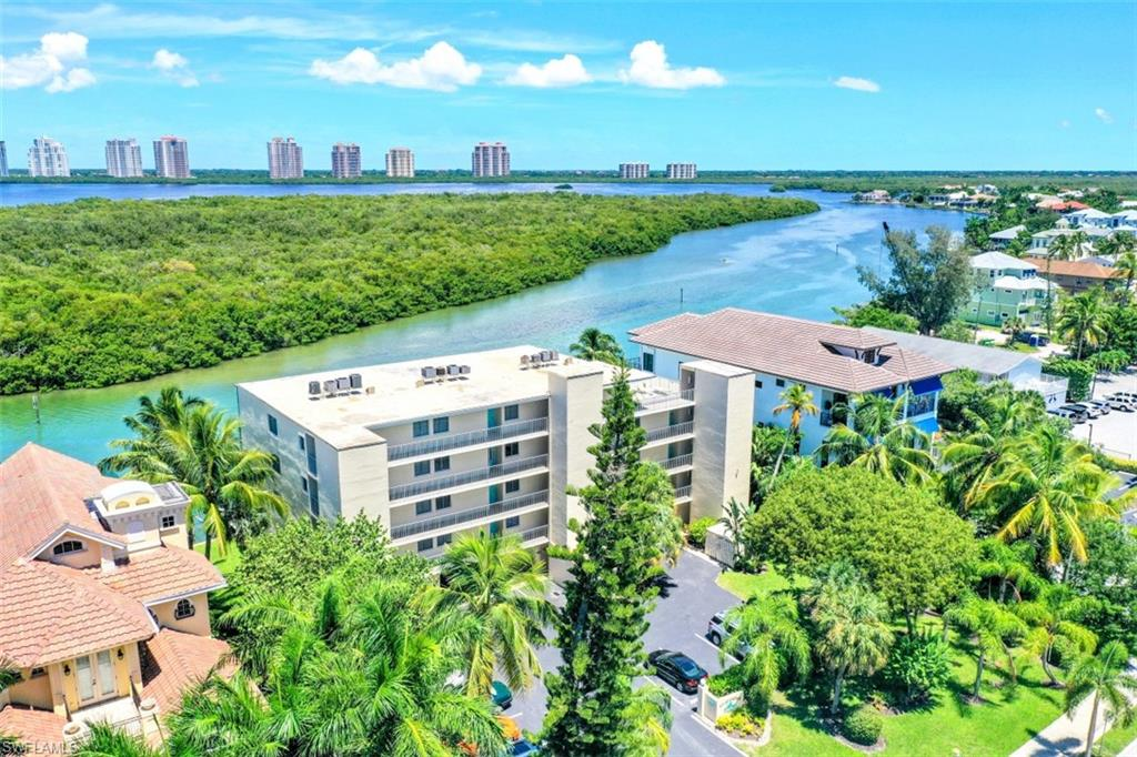 A must see condo for Florida Living at its best. This 2BR/2BA 4th floor unit offers bay views to the east and Gulf views to the west, with even more direct Gulf views from the sundeck. Love boating? A deeded, private boat dock with hoist and davit is included and accommodates a boat up to 25'. Enjoy an early morning sunrise excursion from the Hogue Channel right out to the pristine Gulf waters. Deeded beach access is right across the street for easy enjoyment of sun and fun on beautiful Bonita Beach. Spend the day in the pool or at the beach, then take in the fabulous Florida sunsets on the sunset deck of the 5th floor while enjoying the cool Gulf breezes with your beverage of choice. This unit has been recently painted and is being offered turnkey furnished for immediate enjoyment. While the summer heat is upon us, the cold winter months are just around the corner so plan ahead for your winter getaway! Conveniently located close to shopping, boat rentals, and restaurants. Also included is a separate storage room with ample space to conveniently store all your beach gear, bicycles and more, as well as a covered parking spot under the building - not included with all units.