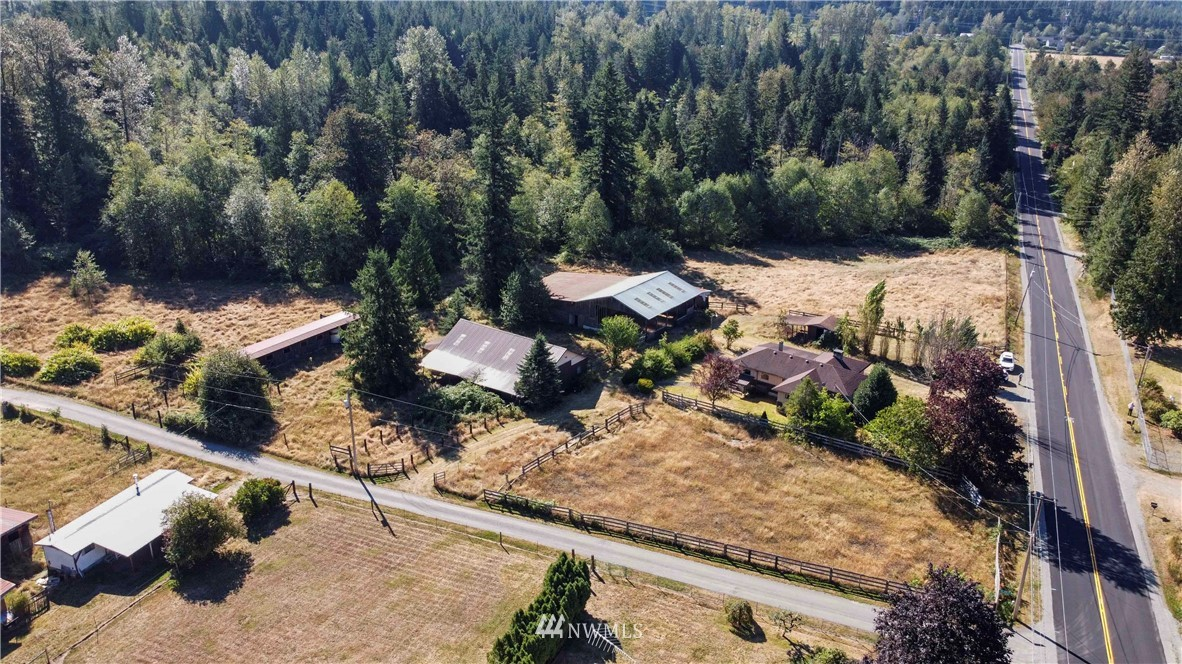 One of a kind opportunity! Long time equestrian owner's property on 5.96 acres w/20+ horse stalls, covered arena & pastures waiting to be brought back to life or developed if you prefer. 5 tax parcels being sold together! Home is cosmetic fixer, ready for your imagination. Cash only due to uniqueness of property.