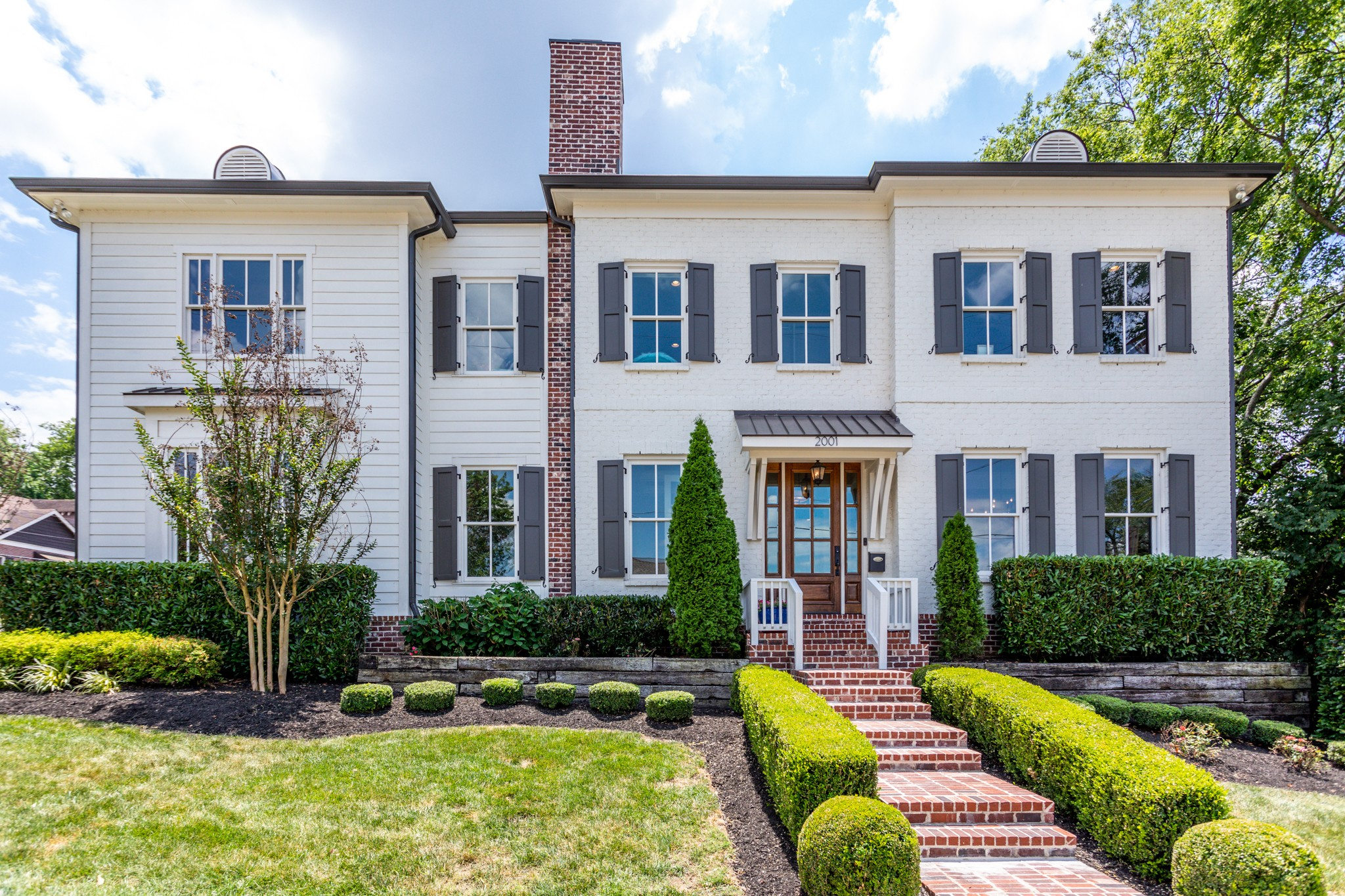 First showing 6/24 at 4:30. Nearly new Hillsboro Village stunner built in 2015. Classic architecture and charm with new home features. Hardwoods, 10' ceilings and master on main level*Honed granite & marble counters in kitchen opening to den, screened porch*main level and second level family rooms plus a bonus room, Hunter Douglas motorized shades.