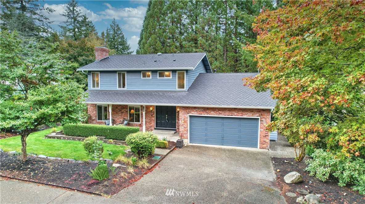 Welcome to Candlewood Ridge & this gorgeous 3 bed, 3 bath home. Backing to a greenbelt w/spectacular redwoods & access to the community walking trail, enjoy the beautifully landscaped back yard w/giant deck, flagstone walkways, raised garden beds & firepit area. Enter to gleaming hardwood floors, large, light-filled rooms, circular floor plan & on-point updates throughout. The kitchen has been beautifully remodeled featuring quartz counters, custom cabinetry w/pull-outs, new stainless steel appliances & large island. On the upper level, enjoy 2 guest rooms & spacious primary suite w/walk-in closet & ensuite 3/4 bath. Absolute must see! Ideally located w/easy access to freeways, SeaTac airport, major retail, dining & business hubs.