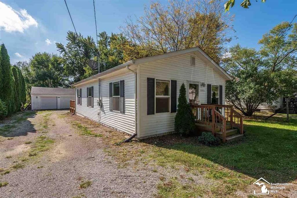 Cute 2 bedroom home on just over a half acre of land on a dead end street. Completely redone about 10 years ago. Washer, dryer, and kitchen appliances stay. Large private backyard. 2 car detached garage. Large deck. 1 year home warranty included.
