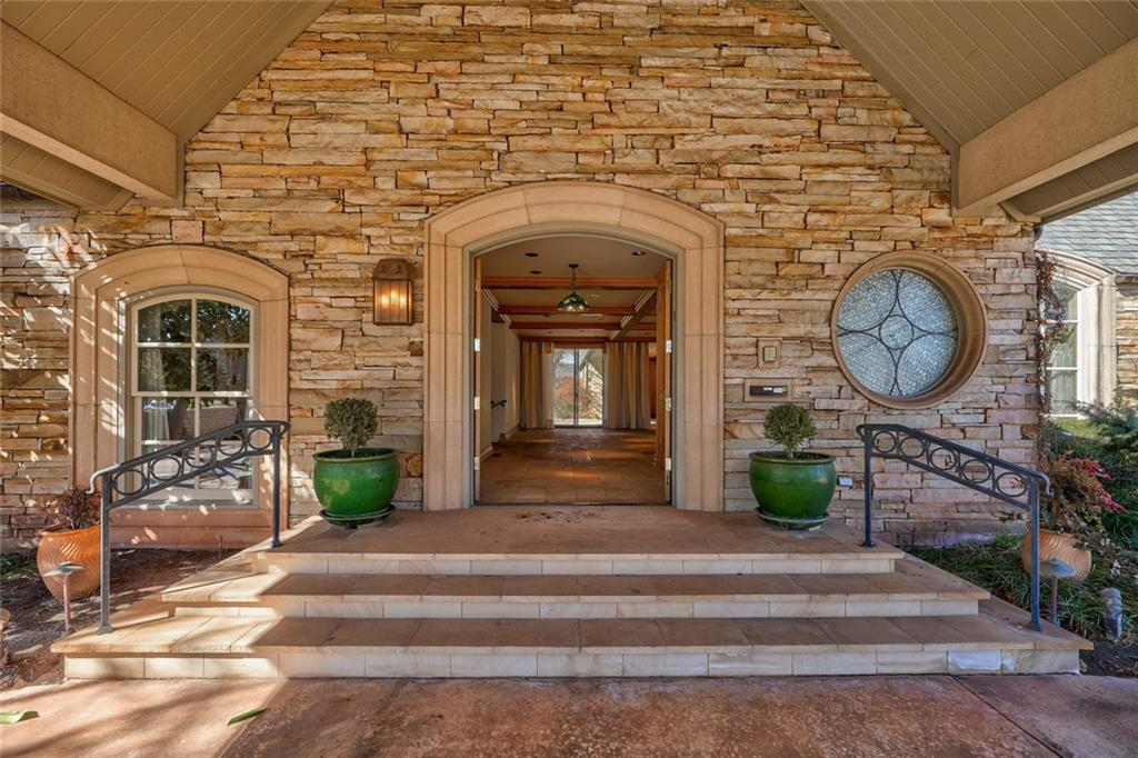 Custom one owner home designed by Rand Elliott with charming stacked stone exterior and one story! Open floor plan with window walls offers tons of natural light and views of the beautiful garden. Great indoor and outdoor entertaining spaces! Large, formal living room with wet bar and a double fireplace to the family room and kitchen. Wonderful formal dining. Large master bedroom with his and her bathrooms, walk-in closets, and private study with fireplace, built-ins, and access to covered patio. Generous storage throughout. 2 additional bedrooms both with private baths and walk-in closets. 3-car garage.