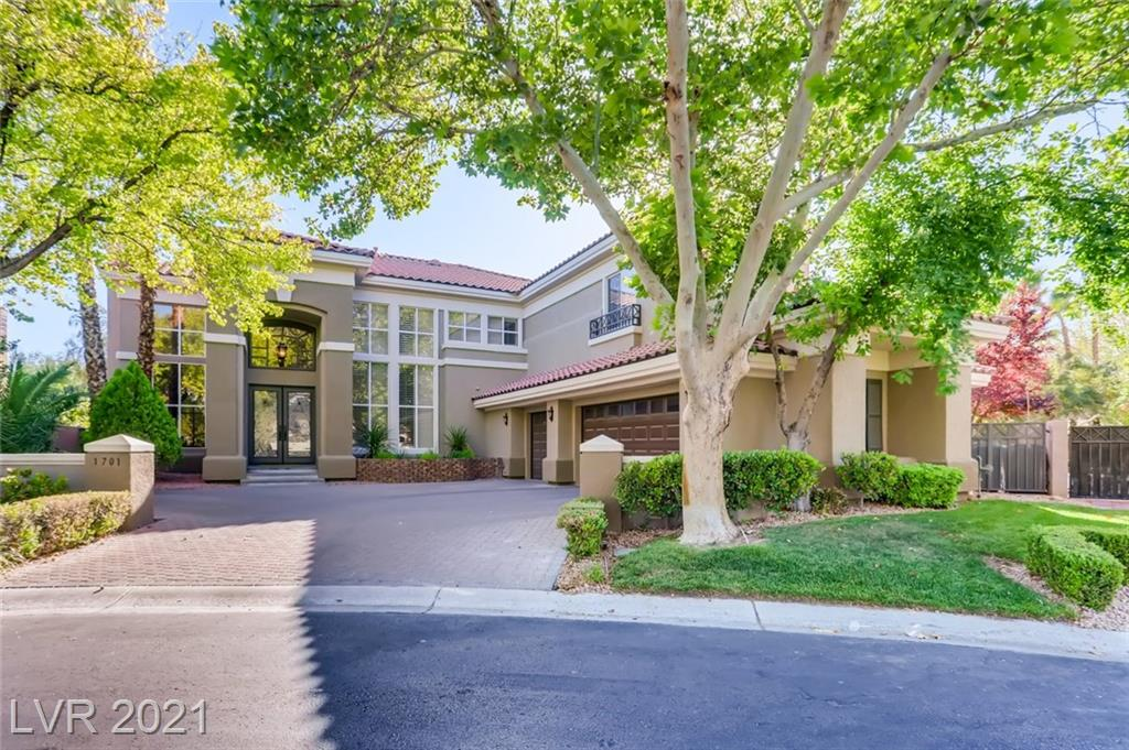 EXQUISITE HOME located on an expansive corner lot in highly sought after Country Club Hills Summerlin. Dramatic entryway welcomes you into the formal living and dining room. Brazilian hardwood floors throughout. Chef's kitchen with built-in SubZero refrigerator, granite countertops, walk-in pantry, and all new appliances.  Spacious family room and separate wet bar. Brand new sliders lead to large covered patio, with sparkling pool, spa, wet deck on one side, and large grass area with gazebo and mature trees. Master bedroom has balcony overlooking backyard, and beautifully remodeled master bath with custom cabinets, tiled shower, soaking tub, and walk-in closets. Remodeled bathrooms and laundry room. All bedrooms ensuite, with full bed and bath dwnstrs. Large loft upstrs. Completely repainted inside and out. Plantation shutters throughout. Whole home water filtration system. Brand new pool heater. Glass/iron front doors, and 3 gas fireplaces. Entertainers dream!