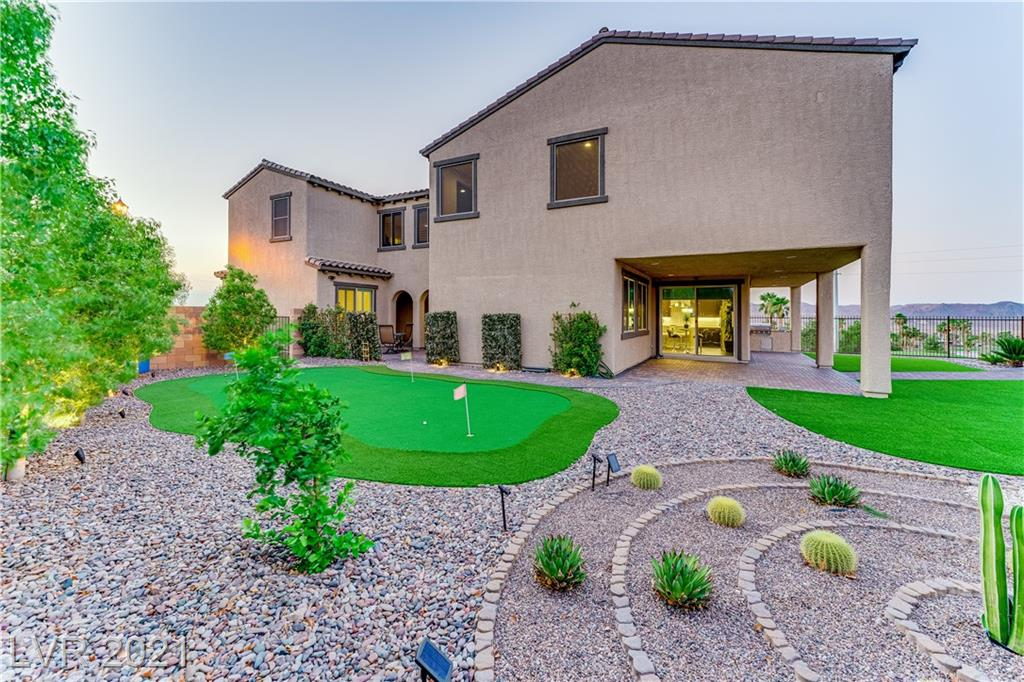 Rare Offering! Perched on the highest peak in Tuscany Village with sweeping Mountain Range, Golf Course, and FULL STRIP views, this end of the cul-de-sac home has breathtaking views from every angle. The positioning of the home delivers privacy with no neighbors on 3 sides. Stepping inside, you'll enjoy the modern themed 3,300+ sqft of living space with private casita including full bath. You will never tire of the world-class view from every room. Enjoy the peaceful tranquility of this 5bd/4.5bath Executive Residence behind the guard gates of Tuscany Village. Modern properties with spectacular views for under $1M are almost unheard of in Las Vegas!