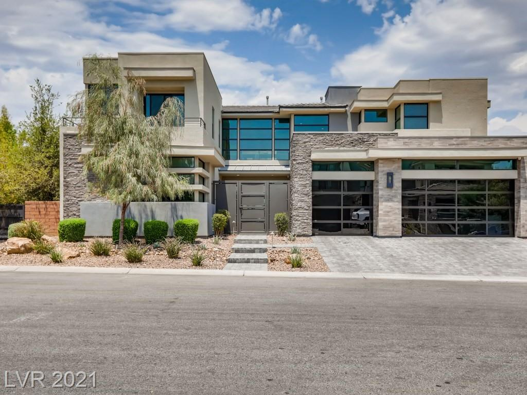 This amazing Desert Contemporary home is located in Silver Leaf at The Ridges Community of Summerlin and features exquisite architecture and high end designer finishes, Seller has over $800K in upgrades. The home showcases an open floor plan with oversized multi-slide pocket glass doors that seamlessly create a soothing indoor/outdoor atmosphere, enjoy the resort-style pool and spa with custom fire pit lounge in the pool, spacious covered patio with a built in BBQ & table, cabana with a built in Bar. The gourmet kitchen comes complete with top of the line Thermador appliances & an oversized kitchen island with waterfall edging. The primary suite has two walk-in closets with custom built-in cabinets, relaxing retreat & large balcony with Mountain View! All the guest bedrooms have ensuite baths with walk-in closets. Fresh Epoxy garage floor! Everything is nearby, Downtown Summerlin is just minutes away! All furniture included as well as over $200K worth of AV & Surround sound equipment.