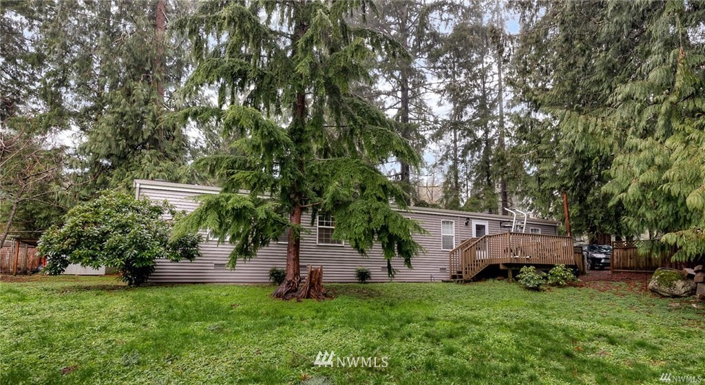 Priced to sell at $510,000! 1+acre of land to build your dream home! Private acreage with room to bring your horses in the spacious barn or turn into a workshop with 1100 sq feet complete with electricity etc. Home is updated in beautiful modern colors with 2 BR /2BA and is move-in ready! So many possibilities for this property! Minutes to shopping and all Redmond has to offer.