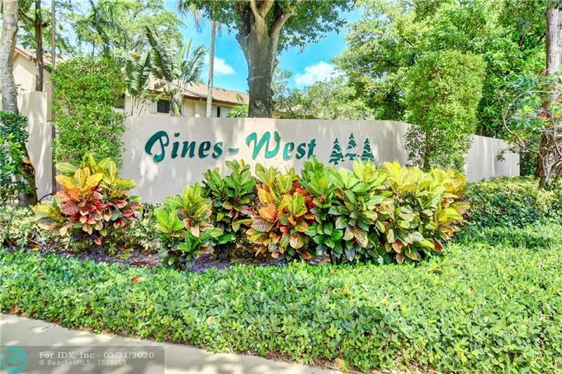 This light & bright, freshly painted townhome is situated just steps from the community's resort-like lakefront pool, clubhouse and fitness center.  It's many features include an open kitchen, spacious living & dining areas, tile on the first floor and brand new carpet on the second, two en-suite bathrooms, a powder room, a washer and dryer, hurricane impact doors, windows and/or shutters throughout and a large private patio which is perfect for entertaining.  Pines West is a beautifully landscaped, pet friendly, gated community ideally located close to Wilton Manors, downtown Fort Lauderdale, the beaches, airport and major highways.  What A Great Place To Call Home!