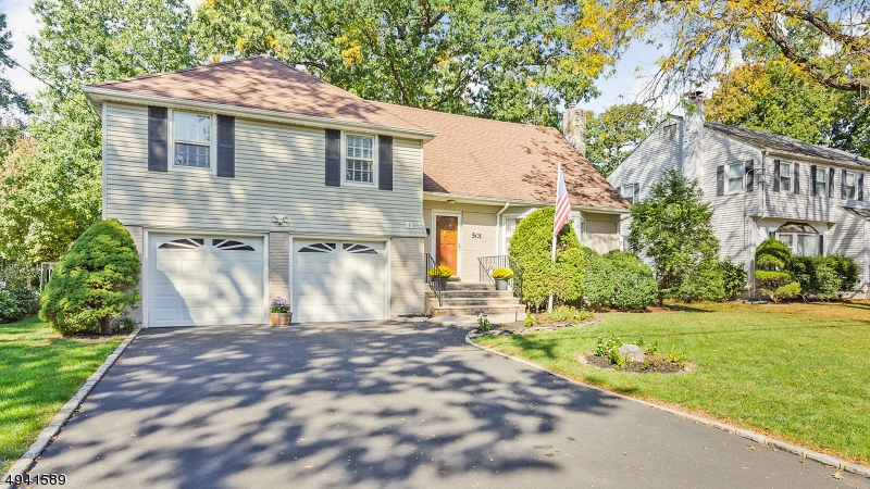 This charming and inviting  Colonial Split Level home is sure to please! There are so many wonderful features, including gleaming hardwood floors, bright and sunny rooms, plenty of storage, & a highly sought location. Enter and take in the living room (which hosts a wood burning fireplace),  formal dining room, eat-in kitchen & heated sunroom. The family room is perfect for entertaining and includes a powder room & exterior access. Entertain your guests on the deck and patio and enjoy the fenced yard. The 2 level offers 3 bedrooms complete with an en-suite and a second full bath. The 4th bedroom s located on the 3rd level. An unfinished basement, security system and two-car garage with interior access complete this lovely home. Located approx 1 mile to the train station and all that downtown Cranford offers!