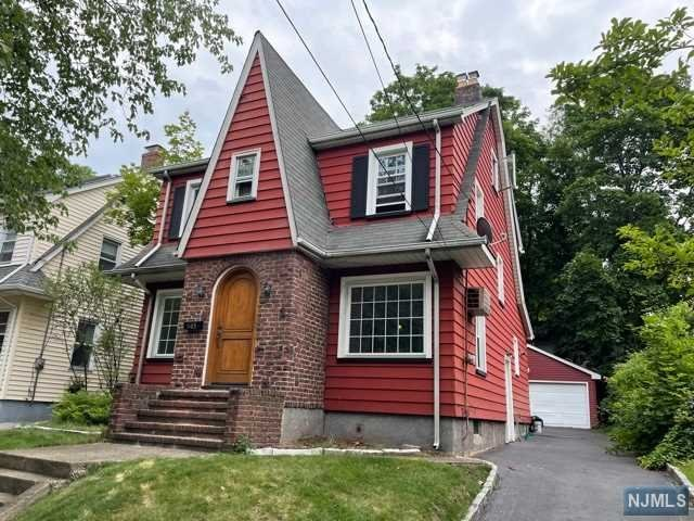 This Teaneck Colonial is sure to win you over! Situated on a lovely tree-lined block, this 3 BDRM/1.5 bth exudes curb appeal, warmth & location.  Enjoy all the features of a loving home- Living Room w/ fireplace(gas), Formal Dining Room,  Eat-in kitchen w/skylight, 1st floor 1/2 bath,3 BDRMS & Full BTH w/ Jacuzzi/shower.  Finished attic makes for a great bonus room or home office.  Full-unfinished basement provides extra space to create the perfect rec. room,office or home gym. Relax/entertain in a private yard w/ deck.  Hardwood Floors throughout. Many updates include: newer furnace, water heater, updated windows, chimney liner, French drains, sump pump & more.  Block's from famed FDU University.   This is a commuter's dream w/ easy access to NYC buses, local shops, parks, malls, highways & Houses of Worship.  Welcome to Teaneck!