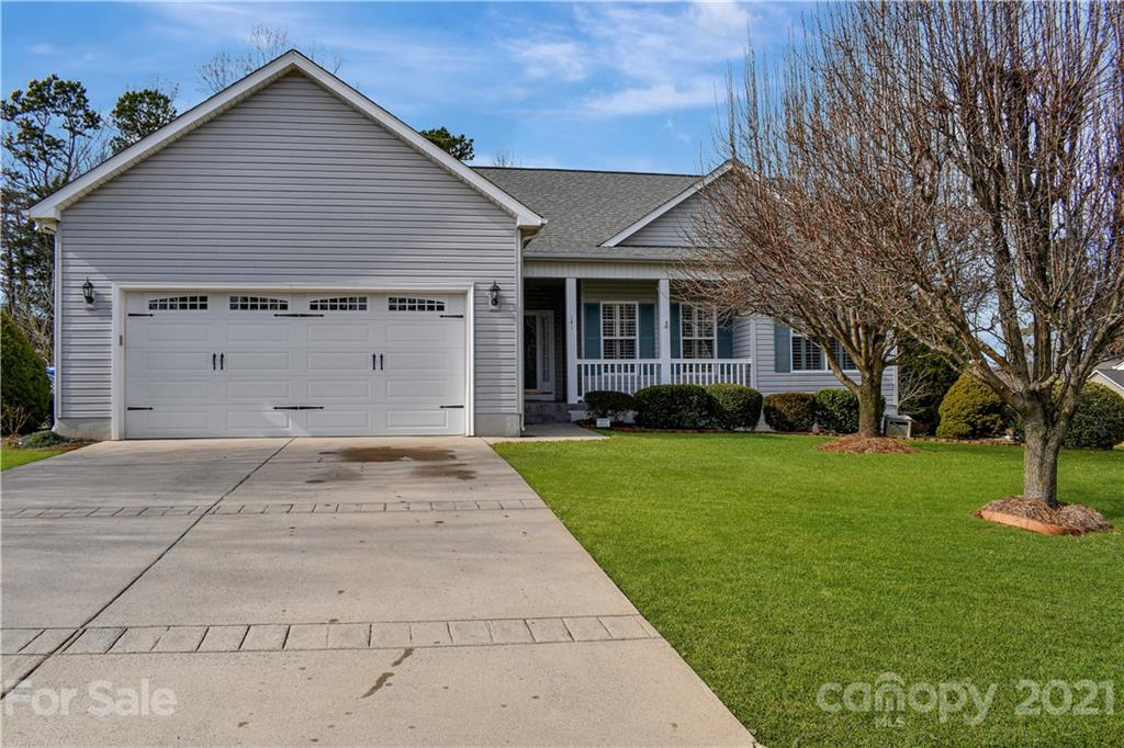 Cheerful & beautiful 3 bedroom 2 bath spacious ranch with a great layout on a flat lot.  What more could you ask for?  Hardwoods in kitchen, breakfast & dining room as well as entry way.  Great room features high ceiling and gas log fireplace.  Large kitchen features lots of storage, oak cabinets, great counter space and a pantry!  Primary bedroom features large sitting room, walk-in closet, en-suite features dual vanity with granite counters, large garden tub and separate shower and a private water closet.  Enjoy spending quiet time on the back deck or on the rocking chair front porch.  This home is well maintained with very nice landscaping.