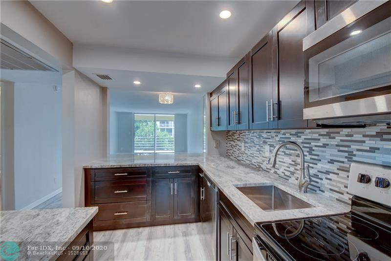 Fully updated 2/2 condo in LHP! Brand new kitchen w/ granite counter-tops & SS appliances, updated bathrooms, large walk-in closets and new floors! Fantastic views of the garden/pool area! HOA $337/month. Minimum 10% down and 640 credit score. Complex includes 2 clubhouses, pool, gym, shuffleboard and more! Available boat dockage for $3/ft up to 25 ft. Minutes to the beach, close to shops, restaurants and bars! Great location - won't last! Condo is move-in ready and priced to sell!