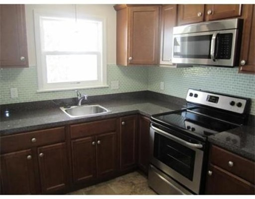 Convenient North Quincy unit that has been completely renovated and minutes to North Quincy T-Station.  Recessed lighting and hardwood floors throughout. Assigned off street parking spot and coin-op laundry in building. Heat and Hot water included!