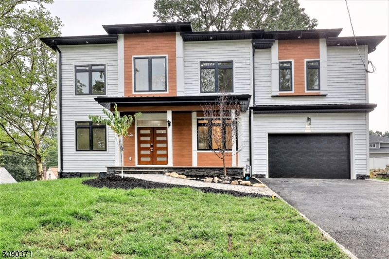 Magnificent custom built 5BR/4.5BA modern and smart colonial with 4200 sq ft of living spaceon .24 acre lot in the cherry hillsec of Livingston! This home boasts a spacious open floor plan, 1st-floor triple-height foyer, LR, FDR, Guest room, Wet bar, Kitchen with high-end SS appliances, centerisland, quartz counters, custom cabinets walk-in-pantry and, Mudroom. The 2nd floor has 4 bedrooms, a luxurious master suite, a 2nd full bath, and a laundry room.Walk-up finished attic is perfect for home office and huge storage rooms all around. Fully finished walk-out lower level with 9' ft ceilings with wet bar, full bath, Media Room, and Rec room. Attached 2 car garage and an additional 4 car parking space. Bckyrd with paver patio & gas line for BBQ.