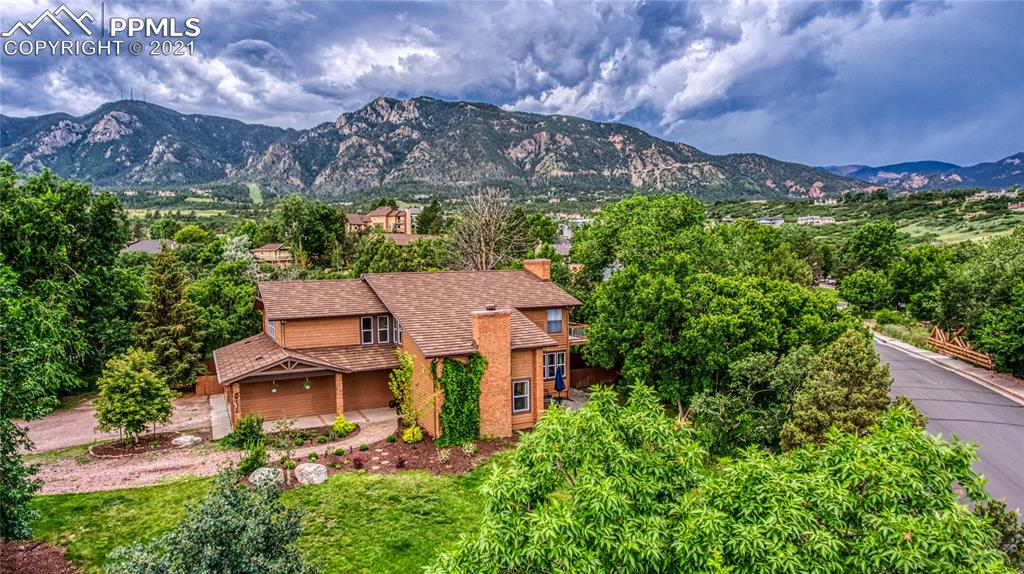 This home is nestled up to Cheyenne Mountain, and masterfully redone with a spa like master bathroom, new kitchen with granite counter tops, new flooring, its truly a must see. The lot is carefully placed with mature beautiful trees surrounding this modern farmhouse style home.