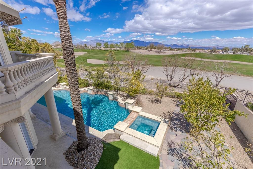 Opulent custom estate on 6th fairway of TPC Las Vegas. Guard gated security. Recently renovated w/new light fixtures, upgraded hardware, fresh paint, & more. Grand entry w/dome ceiling, imperial staircase, wrought iron, & columns. Custom tile, marble, & crown moulding. Indoor/outdoor living w/an abundance of French doors. Kitchen w/stainless Viking & KitchenAid appliances & new quartz countertops. Family room w/generous wet bar & climate-controlled wine cellar. Expansive living/dining wing. Owner's suite w/golf course views, generous balcony, dual vanities, huge walk-in closet, steam shower, new freestanding bathtub, & bonus room. Rear yard w/Pebble Tec pool, raised spa, & built-in bbq. Elevator to upper level. Built-in speakers. Alarm system. Community park w/2 tennis courts, half basketball court, playgrounds, & picnic pavilion.