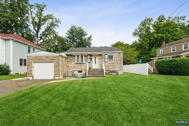 """Great investment opportunity for builders, chance to build your dream home, or enhance this existing three bedroom, two full bathroom ranch with spacious kitchen and one-car garage in the sought-out town of Tenafly. Close proximity to Tenafly schools and convenient location to shopping, parks, and NYC transportation. THE HOUSE IS SOLD """"AS-IS""""."""