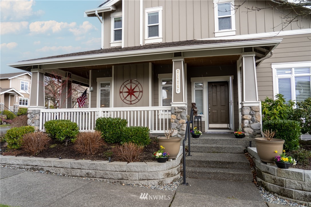 Welcome to this sought after Burnstead 2 story corner home w/ wraparound porch & beautiful hardwood flooring. Updated kitchen boasts nice  island, new cabs w/ lots of drawers, granite counters & SS appliances. Sunken living room has been raised and features lovely fireplace & a family room w/ French doors. Master Suite upstairs w/ sitting area, 5-piece tiled bath & walk-in closet. Heat pump furnace w/ AC!!! Attached 2 car garage. Great location within walking distance of parks, shopping and restaurants, & trails, as well as all the attractions in the Snoqualmie Valley. Close to I-90 w/ access to the mountains heading east or Bellevue, Seattle to the west. Dues cover water and sewer!!! Warranty and home inspection available. THIS is the ONE!