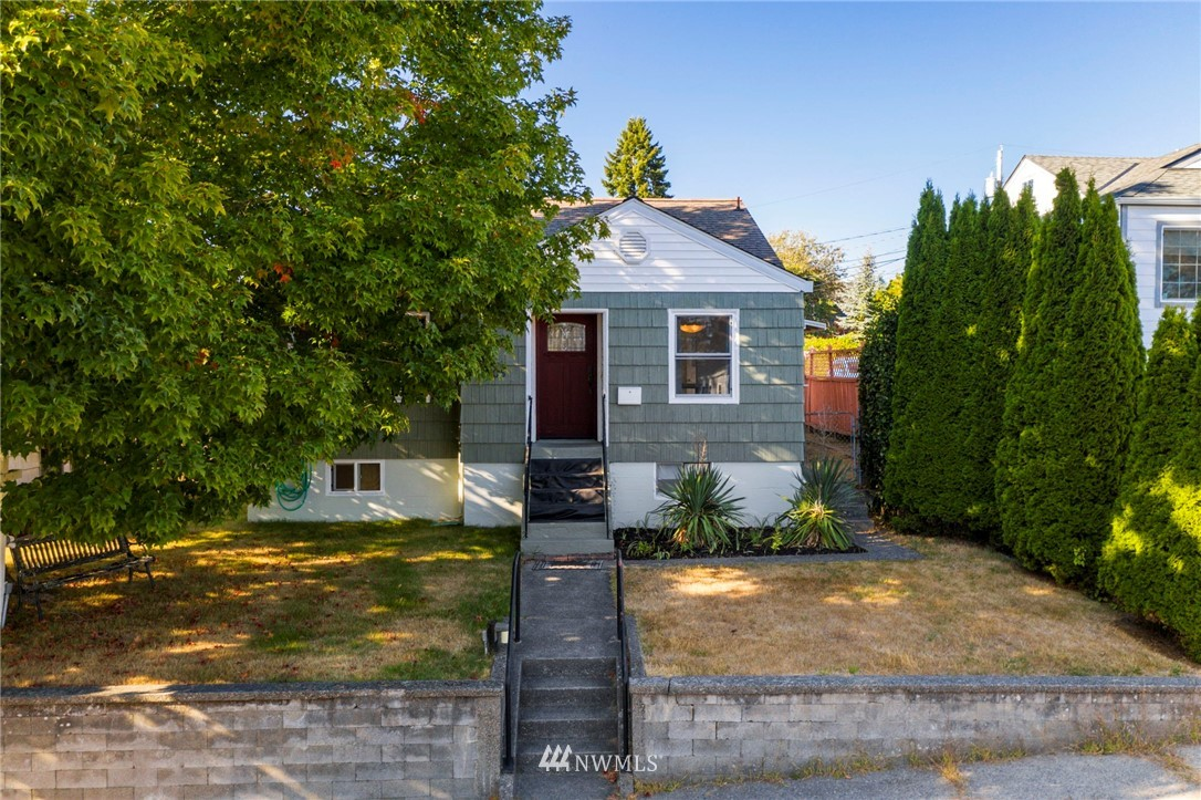 Welcome to this charming 4 bedroom home in Manette on a spacious lot with a mountain view from the upstairs bonus room. Backyard is fully enclosed with a wood fence, original hardwood floors throughout main floor and large partially finished basement offers many possibilities. Substantial New England Sugar Maple Tree shades the front of the home and mature wisteria, yucca tree and golden chain laburnum tree in the backyard.