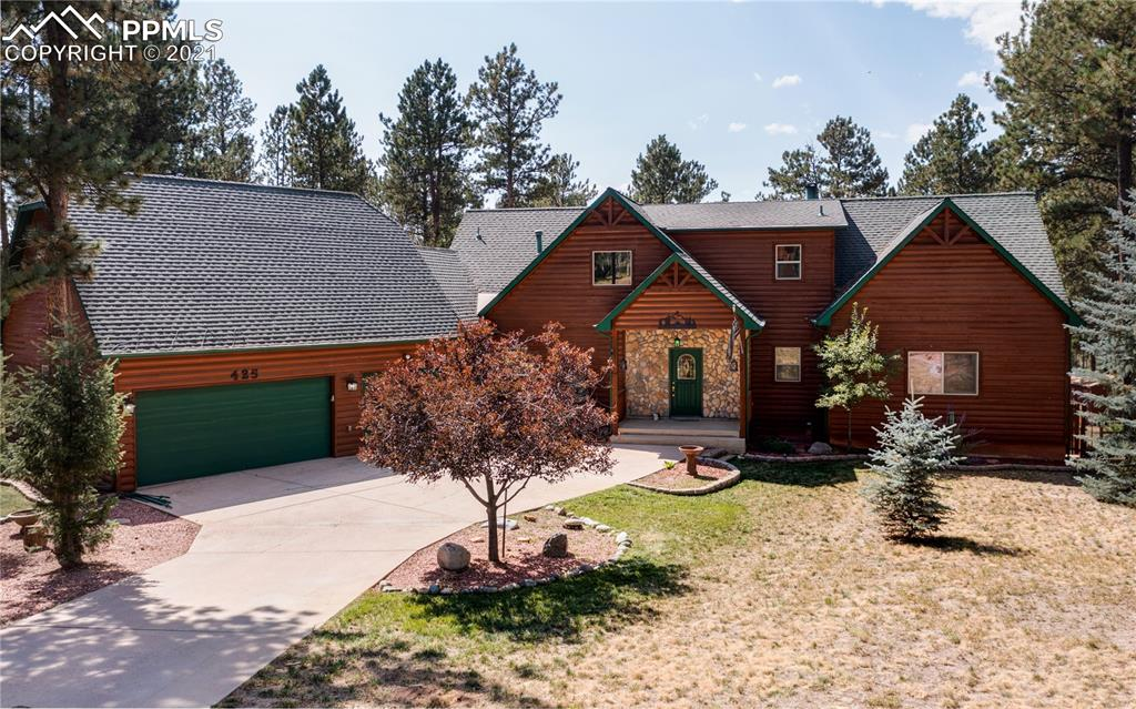 This is a ranch style home with a walkout basement on a spacious 3/4 acre lot located in the exclusive neighborhood, The Reserve at Tamarac. This neighborhood is close to school, downtown Woodland Park, the Shining Mountain Golf Course and plenty of outdoor activities. The home features beetle kill pine tongue and groove walls and trim with solid wood doors, an antler chandelier, stone fireplace, full wall of windows and a trex deck on the main level with wrought iron railing. The kitchen features newer stainless appliances with with a commercial vent hood, double oven and french door refrigerator. The main floor features hardwood flooring with walkouts to the 60ft deck from the dining room, living room and master bedroom. The upper level features two extra large bedrooms with large closets. The basement showcases a family room and fourth bedroom as well as large storage areas in the unfinished portion of the basement. The basement walks out to the expansive backyard that has a fire pit area, plenty of room for entertaining guests, kids to play or your furry four legged friends to run around, and a matching storage shed. The oversized 3 car garage enters the home through a mudroom off the kitchen, which is next to the laundry room as well. Words, however, won't do this home justice. Come see it for yourself! Your new home awaits you! Welcome Home!