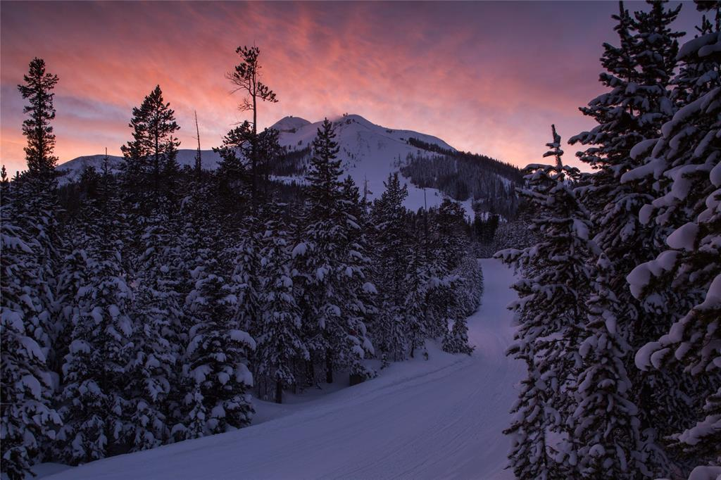 An elevated home site captures beautiful views of the Spanish Peaks, Andesite Mountain and the Challenger area of Lone Peak. There is easy ski-in, ski-out access directly to the lot which borders Big Sky Resort land. Mature trees provide privacy and a true mountain atmosphere for your ski accessible home.