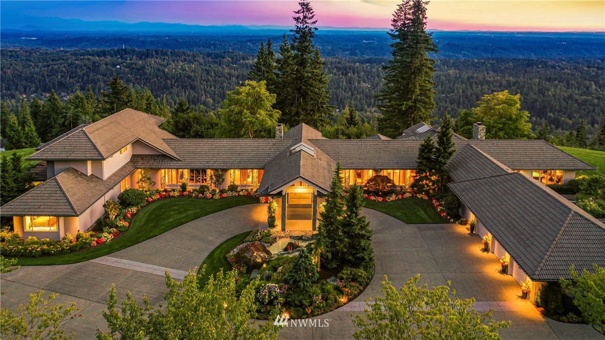 A Masterpiece of NW Modernism // This stunning Ralph Anderson estate offers over 11,000sf of meticulously crafted and impeccably detailed design that frames 270* views sweeping from the North Cascades to the Olympics, including Mt Rainier and beyond. Arranged to integrate organically with its surroundings, the home is a masterful exercise in balancing both its estate stature and graceful elegance using a palette of materials that celebrate the Pacific Northwest. Floor-to-ceiling windows and view corridors emphasize one-of-a-kind outlooks, while metered attenuation of ceiling heights and intuitive flow provide equal measures drama and intimacy. Extraordinary systems and infrastructure afford unmatched privacy, security, and independence.