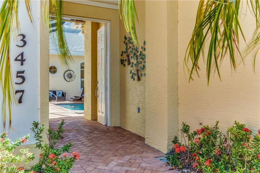 """C.17807 - Step inside and explore this ultra-inviting 3B/3BA courtyard pool home nestled within the unique coastal community of Pelican Landing. Beyond the double french doors awaits a comprehensive floor plan with arched entries, tray ceiling, crown molding, two separate living areas and 2 car garage. Kitchen features granite countertops, beautiful tile backsplash, 42"""" wood cabinets and SS appliances. The courtyard pool offers privacy and a detached 1B/1BA cabana for secluded accommodations for your out-of-town guests. In addition, the home also includes a screened lanai w/lake view and southern rear exposure, perfect for morning coffee or unwinding with your favorite evening beverage. If an elite lifestyle in an amenity rich community is for you!"""