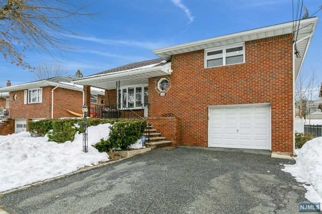 Extraordinary! Beautifully renovated (2016) brick home in heart of Fort Lee conveniently located to NYC Bus, Ferry,  #4 Blue Ribbon School ,shopping (10 mins drive Trader Joe's &  Cafasso Fairway). Impressive details & finishes w open flr plan make this an entertainer's paradise. Inviting covered porch, EF opens to spectacular open Living Space; FLR w Bay window open to one of a kind Gourmet Kitchen ; SS appliances, Granite Cnttops & Bkfst Br. DA with lge window that fills the home w sunshine & views of fenced in yard. O/E to newly constructed covered back porch with skylight, wonderful outdoor living space.  2nd Level: Mst Bdrm w renovated FBth, 2 Bdrms , Renovated Fbth. W/U Attic provides plenty of storage & expansion options . Lower Level: Bdrm w O/E Bkyd. HBth, oversized 1 Car Garage. Bsmt: Spacious Fam Rm w built in bar, storage & lots of space for fun & movie nights. Laundry& Utilities . Amenities: Recessed Lighting, Hdwd Flrs, Roof  (2018), Htwht(2015). CONT ON OWNER BUYING